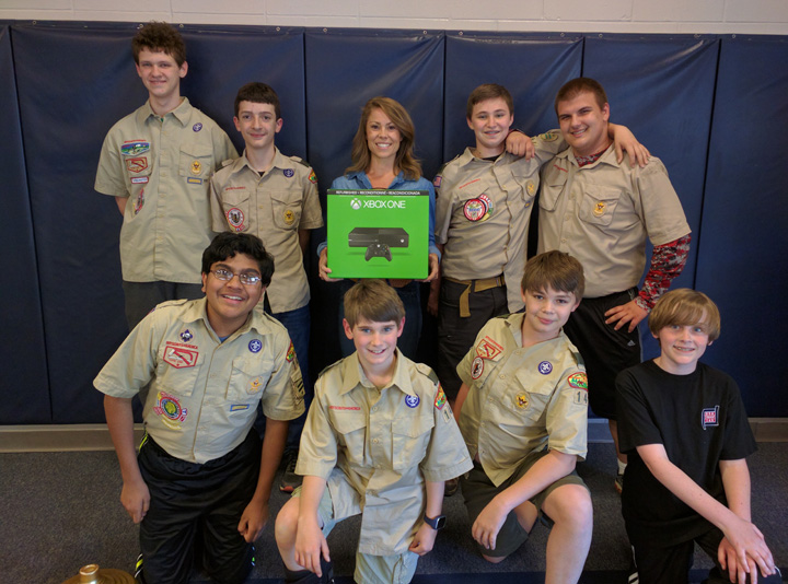 Mrs. Kelly Loew with the Scouts of Troop 149